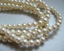 Lustrous AA White Freshwater Pearl Round Beads - 7mm