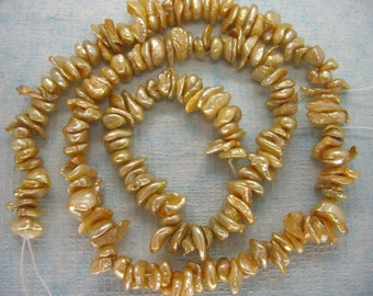 Center Drilled Shampagne Keishi Freshwater Pearls - 15.5 Inch Strand