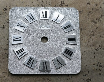 Vintage Soviet alarm clock dial -- plastic