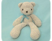crochet bear in light blue, teal, and creme