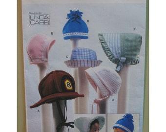 "Six Baby Bonnets, Hats Pattern Fire Fighter Helmet, Sunbonnet, Winter Hat, Fits Newborn, Small, Med - Vogue 7705 UNCUT Head Size 18 18.5 19"""