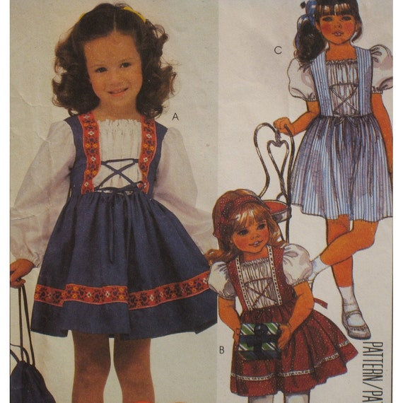 """Girls Heidi-Look Dress Pattern, Pullover, Ruffle Insert, Lace Up Front, Puff Sleeves, Purse,McCalls No. 9417 UNCUT Size 4 (Breast 23"""" 58cm)"""