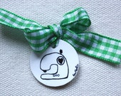 Machine love charm with green ribbon
