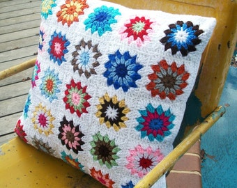 granny square crocheted pillow with four button closure