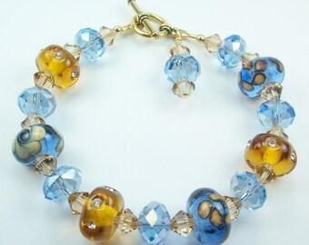 Lampwork Glass Bracelet - blue, amber, Swarovski crystals