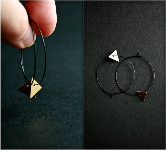 triangle earrings. large hoops. pyramids. brass charms on large black hoops. by baltica