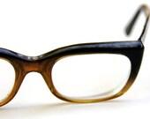 1950's. cat eye. brown n' black rim. glasses. rockabilly. vintage.