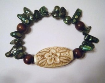 Plumeria antiqued bone bracelet with abalone shells