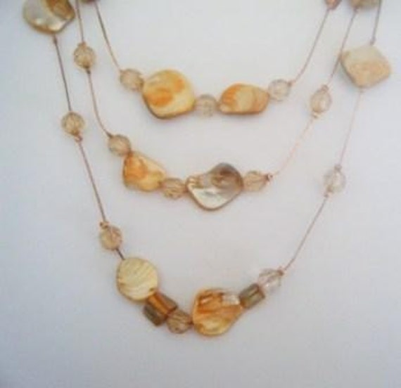 Peach triple-strand mussel shell necklace