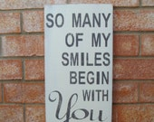 So Many of my Smiles Begin with You - Distressed Antique White Wood Sign