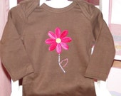 Infant baby onesie embellished with flower applique and rhinestones