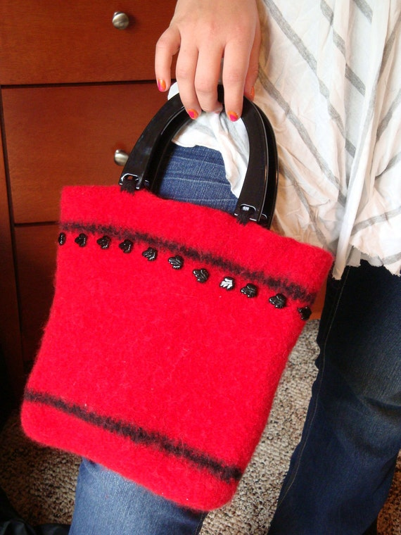 red purse with studs