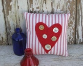 Primitive heart cupboard tuck