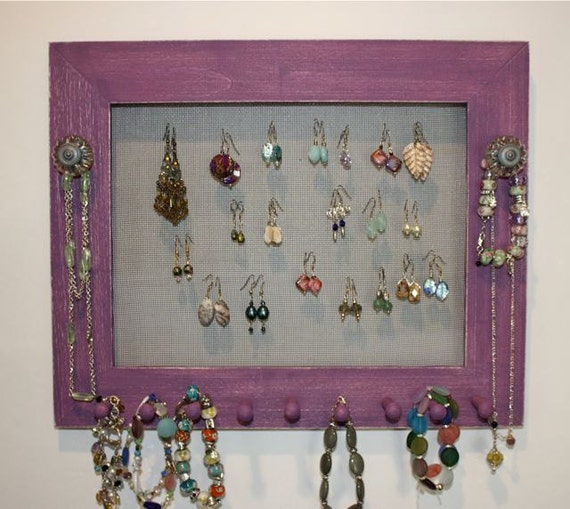Purple Jewelry Holder Organize Earrings On The Wall.