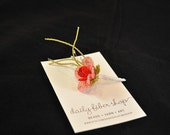Red and Pink Beaded Boutonniere