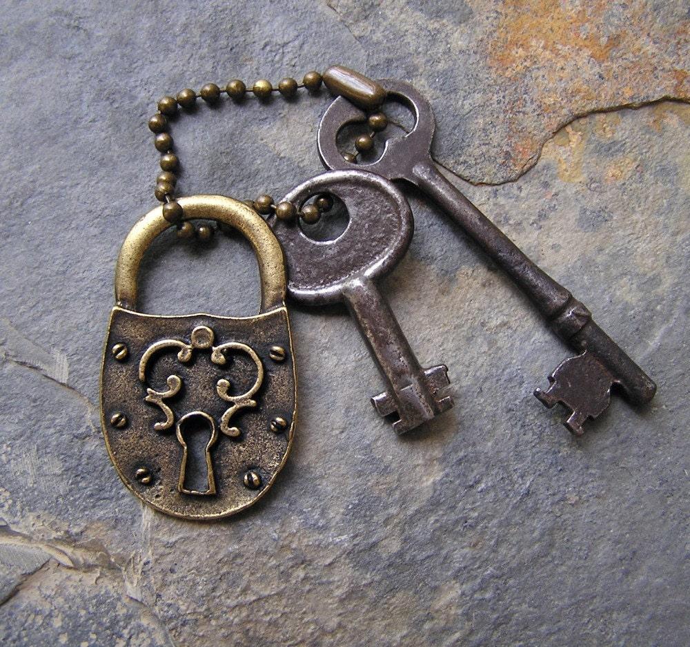vintage skeleton keys and medieval style brass lock. Black Bedroom Furniture Sets. Home Design Ideas
