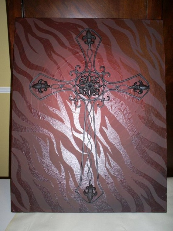 Metal art mounted on painted canvas