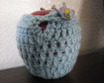 Crocheted Apple Jacket with watering can button