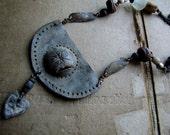 where the secret sits. warrior talisman necklace.