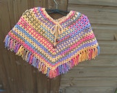 Childs handcrocheted poncho. Paintbox