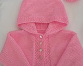 Baby hooded jacket, Childs sweater, knitted coat, baby hoodie.Tassled hood Hand knit. Pink. Newborn/3mths.