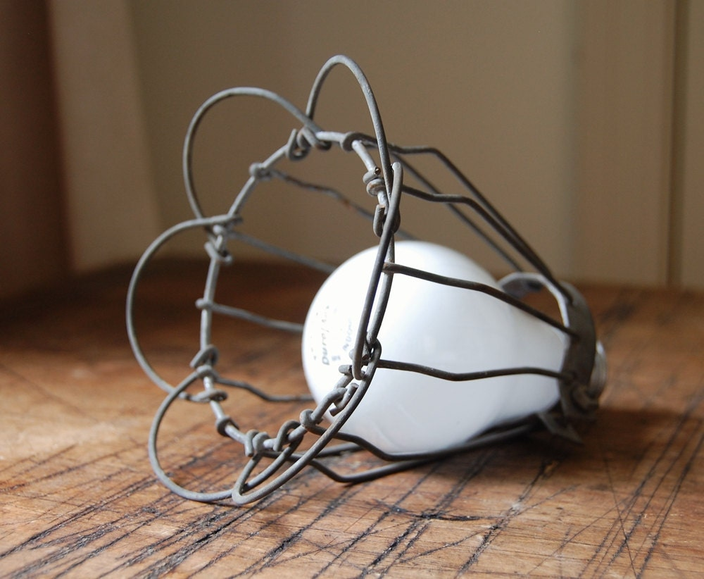 vintage wire light bulb cage with folding petal edges. Black Bedroom Furniture Sets. Home Design Ideas
