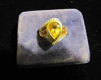A Citron ruby gold ring for sale with diamonds