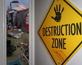 "12"" x 12"" Construction Themed Yellow Gloss Metal Destruction Zone Road Traffic Wall Sign with hand print and scribble"