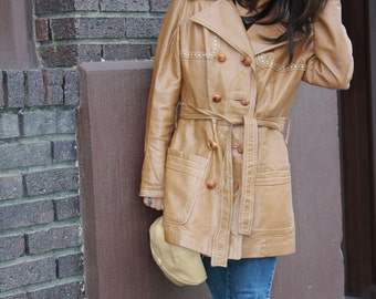Vintage double breasted leather jacket with wooden buttons.