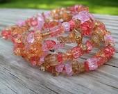 Slinky bracelets - pink and orange crackle glass chips