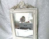 NEW LISTING----a distressed mirror with applique at the top