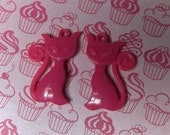 2 hot pink cat pendents