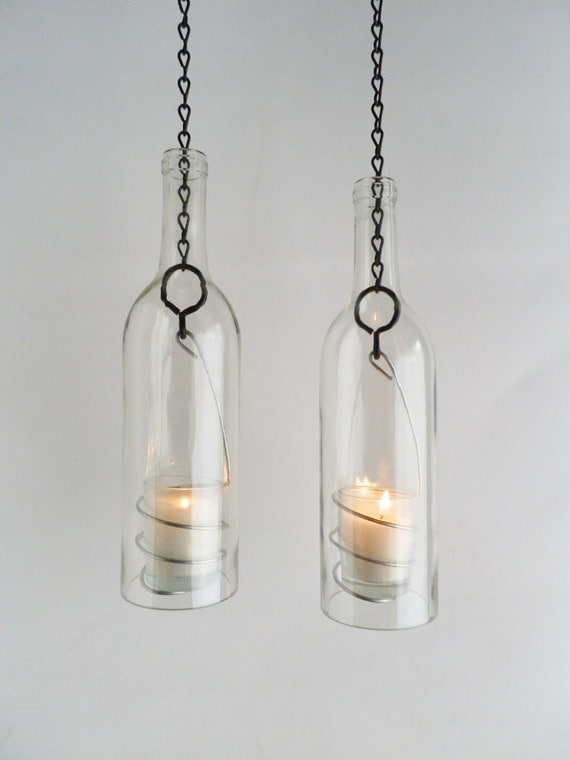 two clear glass wine bottle candle holder hanging by bomolutra