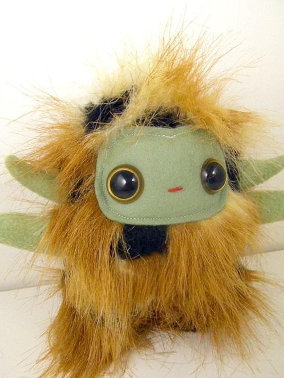 Jaromir the horned plush monster tan brown balack and olive green stuffed animal