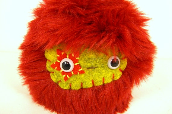 Starlette the plush monster red and mustard yellow Poppumm stuffed animal