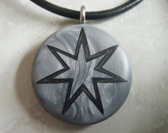 Heptagram / Fairy Star hand carved on a polymer clay grey pearl color background. Pendant comes with a FREE pendant