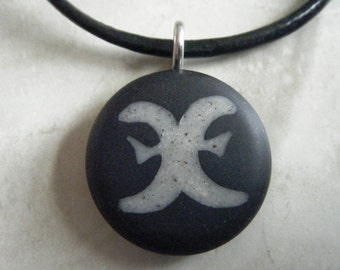 Pisces Zodiac signs hand carved on a polymer clay black color background. Pendant comes with a FREE 3mm necklace.