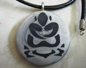 buddha-lotus hand carved on a polymer clay grey pearl swirl background. Pendant comes with a FREE necklace