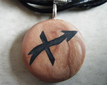 Zodiac SAGITTARIUS signs hand carved on a polymer clay Copper pearl color background. Pendant comes with a FREE 3mm necklace.