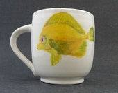 Wheel thrown, hand painted ceramic mug a with painting of yellow tropical fish