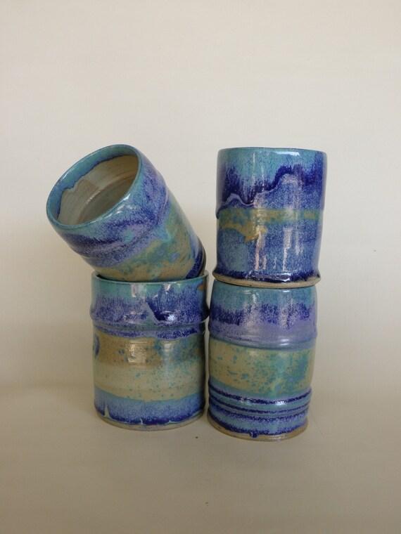 Four ceramic cups (tumblers)