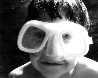 Boy swimming with huge goggles. 'Goggled'. Black & White photograph. Limited Edition print one of only 25. FREE world Postage