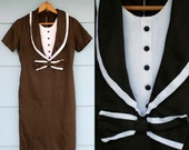 1960s. chocolate brown tuxedo bow dress. s
