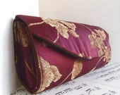 Clearance. Burgundy and gold clutch bag, leaf pattern
