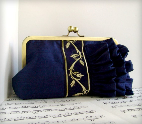 Navy blue silk clutch with ruffles and gold and blue ribbon