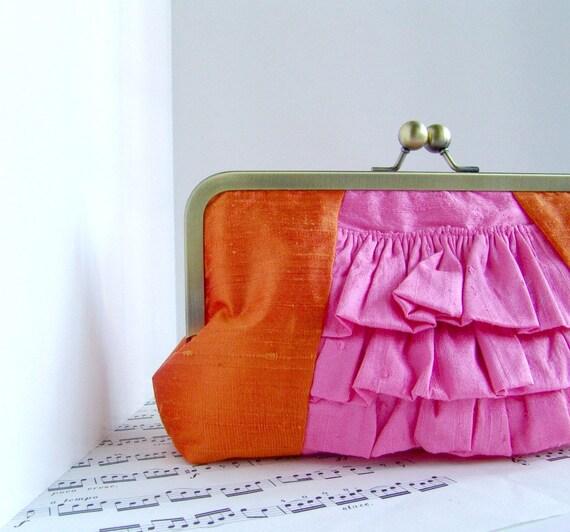 Tangerine orange and pink ruffled silk clutch in frame, spring fashion