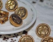 Set of 9 gold colored plastic crown vintage buttons