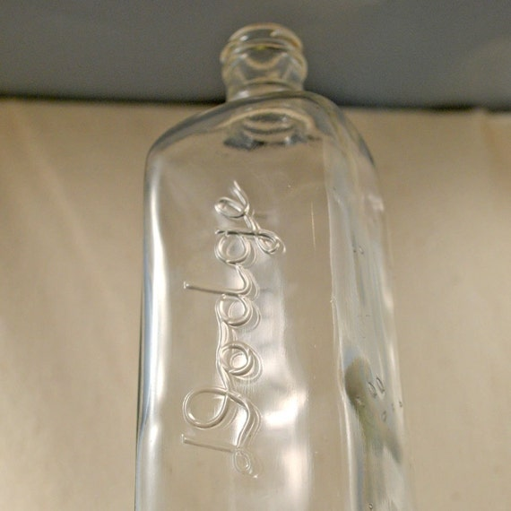Old embalming glass bottle from the 1920s  (Dodge)