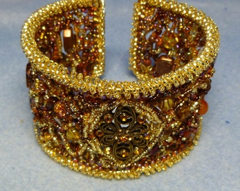 Gold and copper freeform beaded bangle