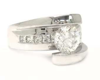Round and princess cut diamond engagement ring tension set 1.47ctw
